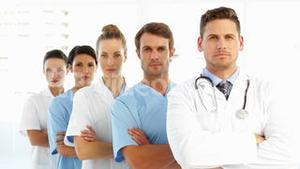 Frowning medical team with arms crossed