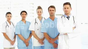 Frowning medical team with hands together