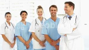 Happy medical team with hands together