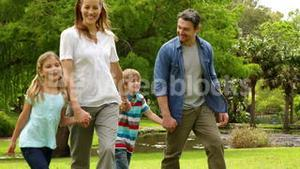 Happy family walking in the park together