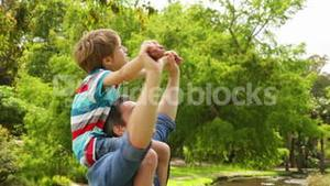 Happy father giving his son a piggy back