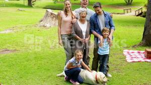 Multi generation family smiling at camera in a park