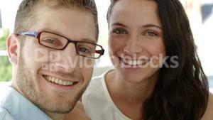 Portrait of attractive coworkers smiling at camera