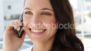 Cheerful businesswoman being on the phone