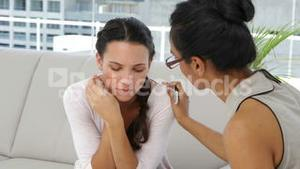 Attractive psychoanalyst talking with young woman