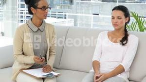Female psychoanalyst talking to depressed woman