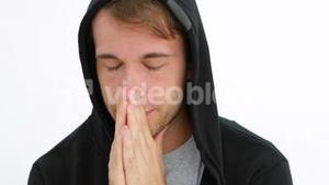 Desperate young man praying