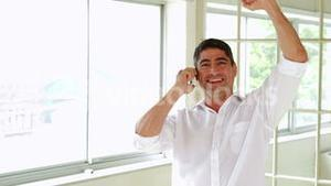 Cheerful man having a phone call