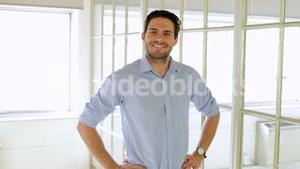 Content handsome man posing with hands on hips