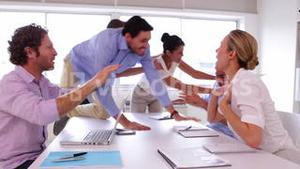 Business team disagreeing and fighting