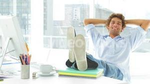 Relaxed businessman reclining on his swivel chair