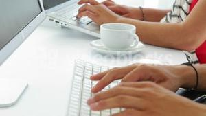 close up of young female creative designer working on computer