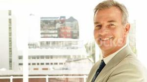 Businessman turning to camera with arms crossed