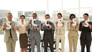 Business team holding letters spelling success