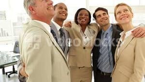Business people embracing each other