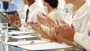 Business people clapping at presentation