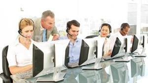 Manager checking on call centre agents