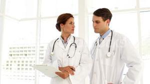 Doctors speaking about a file