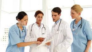 Medical team discussing a file