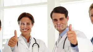Medical team giving thumbs up to camera