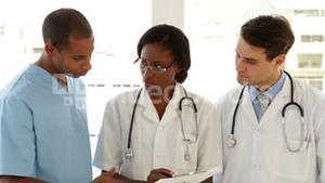 Happy medical team speaking about file