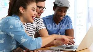 Editing team working on laptop together