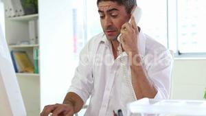 Businessman working and talking on the phone