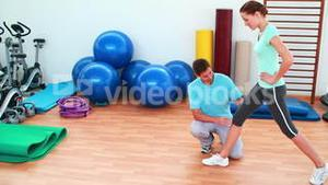 Trainer showing his client how to lunge correctly