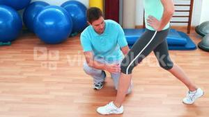 Trainer showing his client how to do a lunge correctly