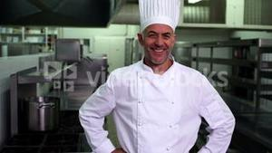 Head chef smiling at camera with hands on hips