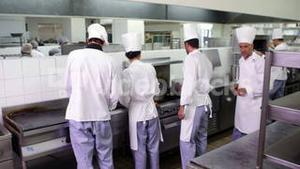 Chefs at work in a busy kitchen
