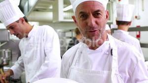 Chef showing his spaghetti bolognese to camera