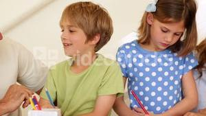Cute parents and children doing arts and crafts together