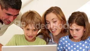 Cheerful parents and children doing arts and crafts together