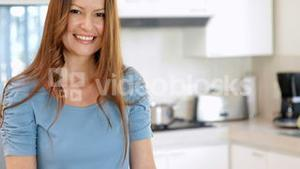 Smiling woman preparing vegetables on the chopping board