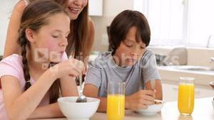 Brother and sister eating cereal together