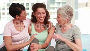 Three happy women smiling at the camera
