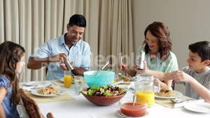 Family having a spaghetti dinner together
