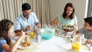 Happy family having a spaghetti dinner together