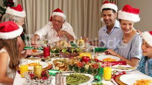 Smiling extended family at the christmas dinner table