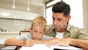 Father helping his son with his homework