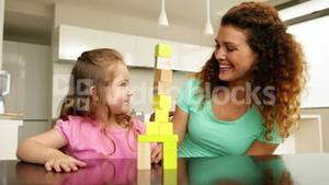 Mother and daughter playing with building blocks