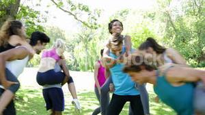 Fit group of friends having fun and messing in the park