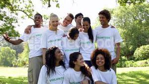 Group of volunteers smiling at the camera