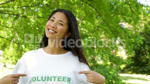 Pretty volunteer smiling at the camera