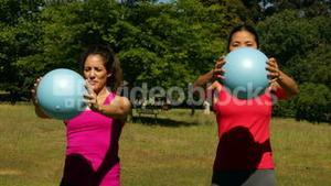 Fitness group working out with medicine balls