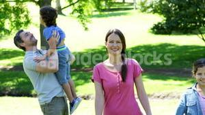 Happy family in the park together