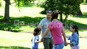 Happy family playing in the park together