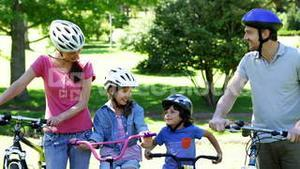 Happy family on a bike ride in the park together