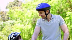 Father and son on a bike ride in the park together